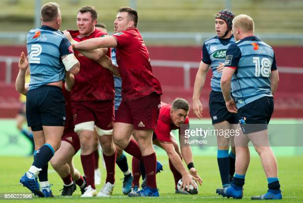 Peter O'Mahony and Niall Scannell of Munster attacking Matthew Rees of Cardiff during the Guinness PRO14 Conference A Round 5 match between Munster...