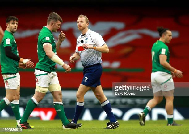 Peter O'Mahony of Ireland is shown a red card by Referee, Wayne Barnes during the Guinness Six Nations match between Wales and Ireland at the...