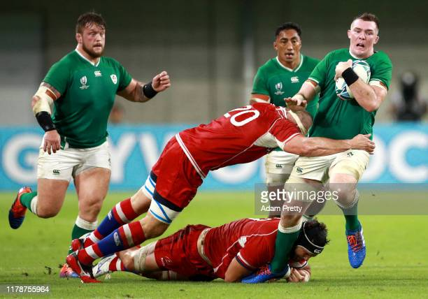 Peter O'Mahony of Ireland is tackled by Evgeny Elgin and Andrey Ostrikov of Russia during the Rugby World Cup 2019 Group A game between Ireland and...