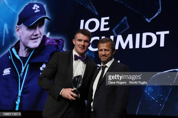 Peter O'Mahony of Ireland on behalf of Joe Schmidt of Ireland receives the World Rugby via Getty Images Coach of the Year award from Fabien Galthie...