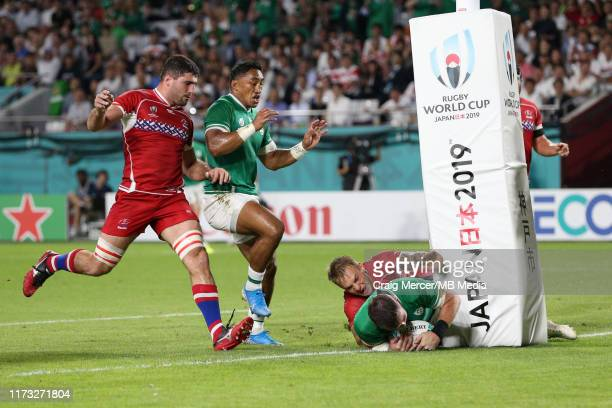 Peter OMahony of Ireland scores his side's second try despite the tackle of Kirill Golosnitskiy of Russia during the Rugby World Cup 2019 Group A...
