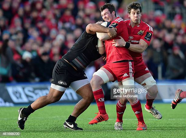 Peter O'Mahony of Munster is tackled by Billy Vunipola of Saracens during the European Rugby Champions Cup match between Saracens and Munster Rugby...