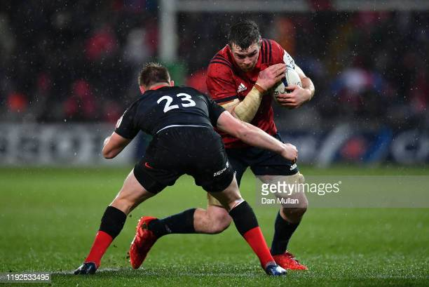 Peter O'Mahony of Munster takes on Nick Tompkins of Saracens during the Heineken Champions Cup Round 3 match between Munster Rugby and Saracens at...