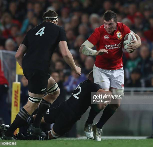Peter O'Mahony of the Lions is held by Aaron Crude during the Test match between the New Zealand All Blacks and the British & Irish Lions at Eden...