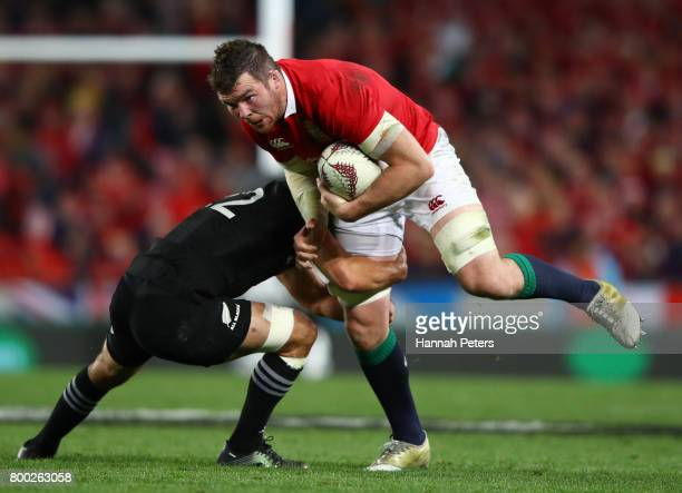 Peter O'Mahony of the Lions is tackled by Aaron Cruden of the All Blacks / Lima Sopoaga of the All Blacks during the first test match between the New...