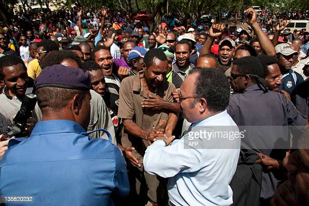 Peter O'Neill protest greets supporters in Port Moresby on December 15 2011 Police were ordered to take control of Papua New Guinea's government...
