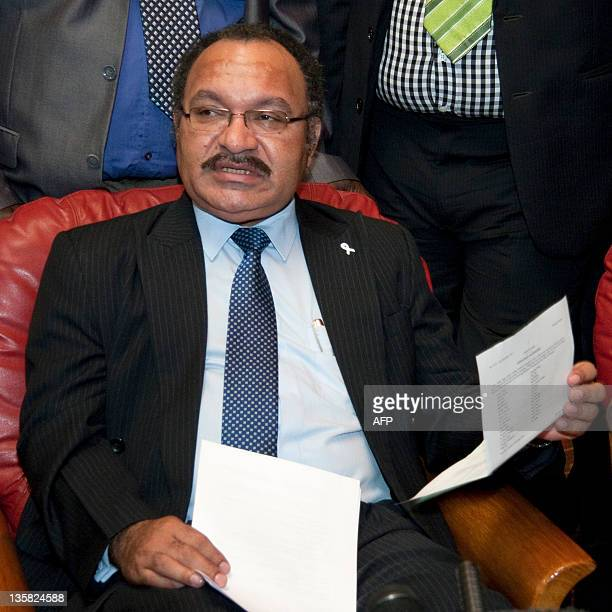 Peter O'Neill protest speaks at a press conference in Port Moresby on December 15 2011 Police were ordered to take control of Papua New Guinea's...