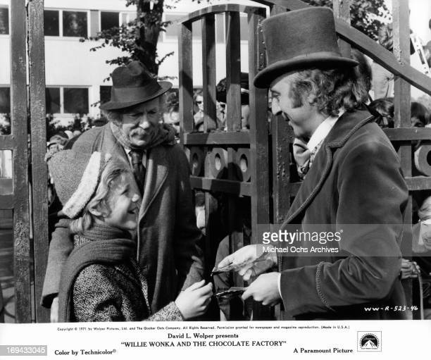 Peter Ostrum and Jack Albertson are greeted at the factory gate by Gene Wilder in a scene from the film 'Willy Wonka & the Chocolate Factory',...
