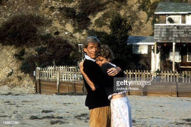Peter O'Toole and Mariel Hemingway embracing in a scene from the film 'Creator', 1985.