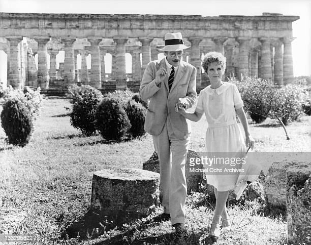 Peter O'Toole and Petula Clark explore the ruins at Paestum in a scene from the film 'Goodbye Mr Chips' 1969