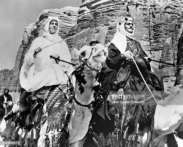 Peter O'Toole , as T. E. Lawrence, and Omar Sharif as Sherif Ali ibn el Kharish, riding camels in a scene from 'Lawrence Of Arabia', directed by...