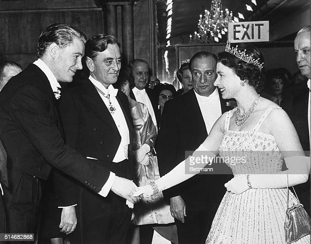 Peter O'Toole bows to Queen Elizabeth II after a Command Performance showing of Lawerence of Arabia, in which he played the title role. The film's...