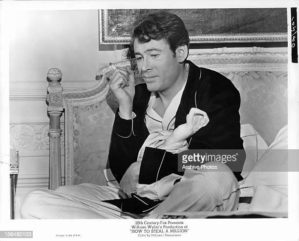 Peter O'Toole clutches a statue in a scene from the film 'How To Steal A Million', 1966.