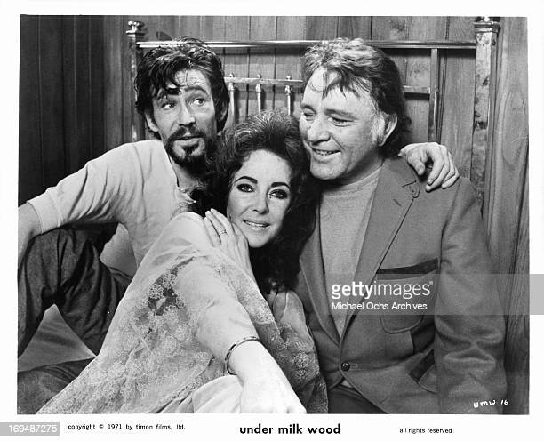 Peter O'Toole Elizabeth Taylor and Richard Burton crowd on a bed during a break from shooting the film 'Under Milk Wood' 1972