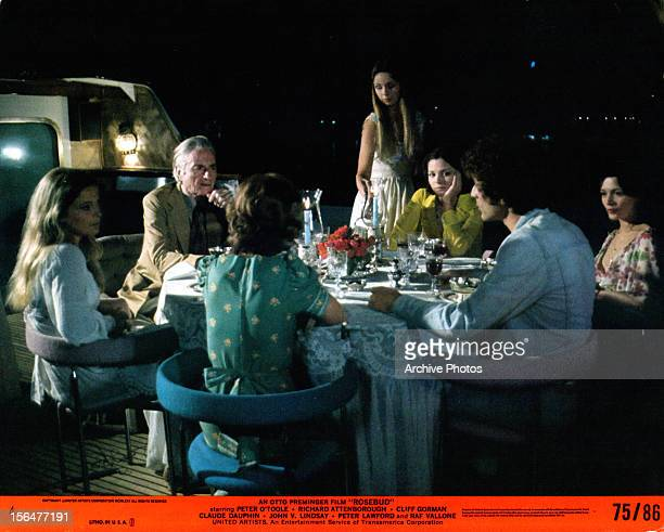 Peter O'Toole has dinner with his family in a scene from the film 'Rosebud', 1975.