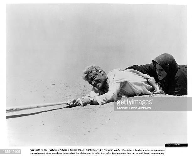 Peter O'Toole is dragged across the sand in a scene from the film 'Lawrence Of Arabia', 1962.