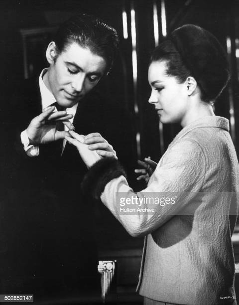 Peter O'Toole puts a ring on Paula Prentiss finger in a scene of the movie What's New Pussycat circa 1965