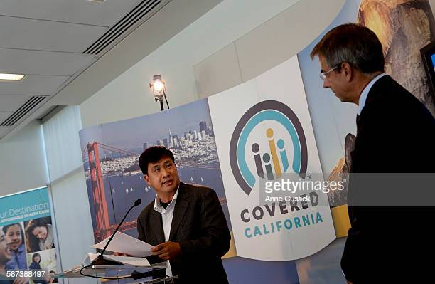 Peter Park, left, board member with Koreatown Multipurpose Senior Center speaks during a press conference at which Covered California Executive...