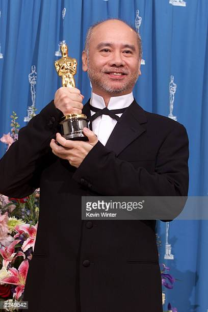 Peter Pau Oscar winner for Achievement in Cinematography for his work on Crouching Tiger Hidden Dragon poses backstage at the 73rd Annual Academy...