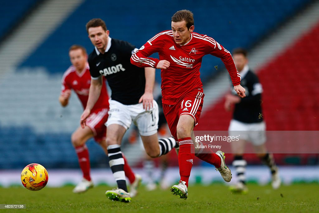 Peter Pawlett of Aberdeen goes past Callum Morris of Dundee Utd during the Scottish League Cup Semi-Final match between Dundee United and Aberdeen at Hampden Park on January 31, 2015 in Glasgow, Scotland.