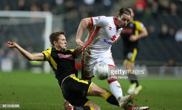Peter Pawlett of Milton Keynes Dons plays the ball under pressure from Will Vaulks of Rotherham United during the Sky Bet League One match between...
