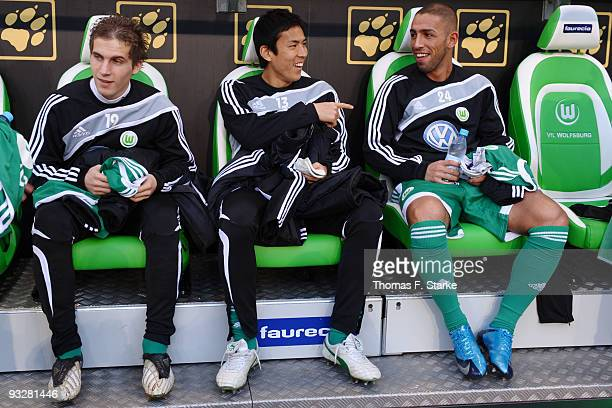 Peter Pekarik Makoto Hasebe and Ashkan Dejagah of Wolfsburg sit on the substitutes bench prior the Bundesliga match between VfL Wolfsburg and 1 FC...