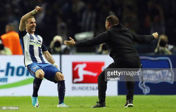 Peter Pekarik of Berlin celebrates his team's first goal with head coach Pal Dardai during the Bundesliga match between Hertha BSC and TSG 1899...