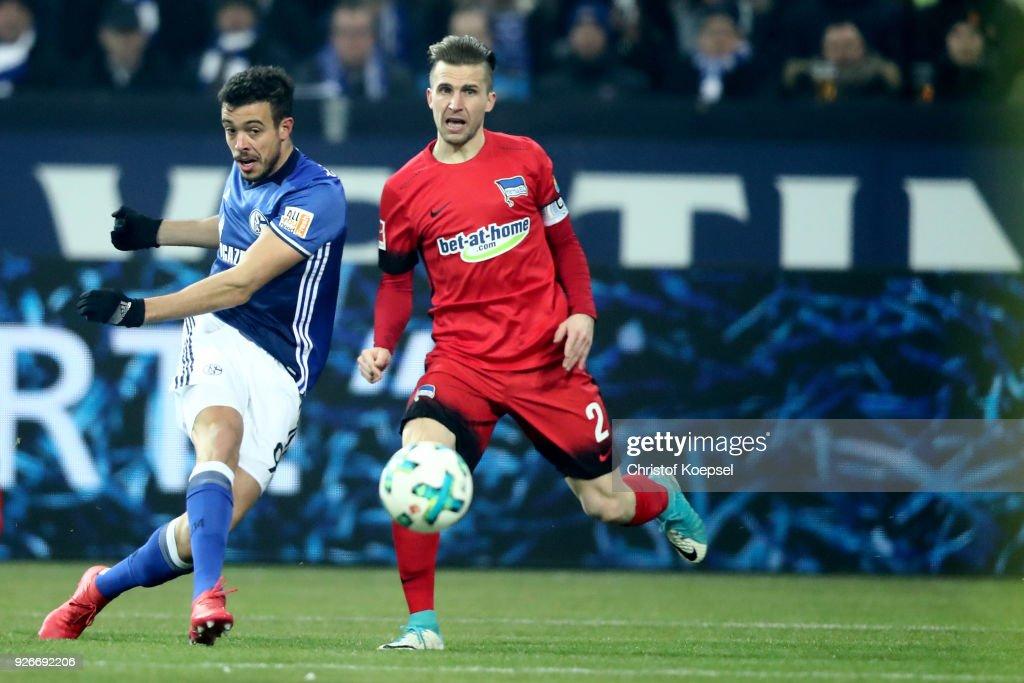Peter Pekarik of Berlin (R) challenges Franco Di Santo of Schalke (L) during the Bundesliga match between FC Schalke 04 and Hertha BSC at Veltins-Arena on March 3, 2018 in Gelsenkirchen, Germany.