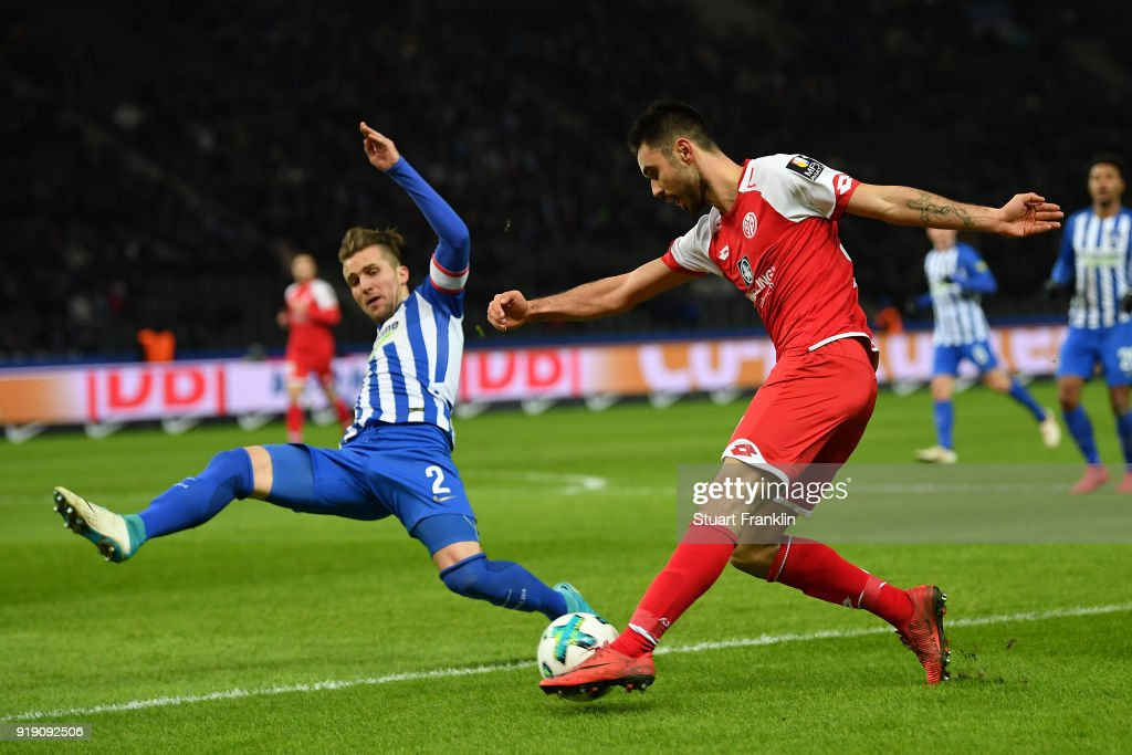 Peter Pekarik of Berlin is challenged by Gerrit Holtmann of Mainz during the Bundesliga match between Hertha BSC and 1. FSV Mainz 05 at Olympiastadion on February 16, 2018 in Berlin, Germany.