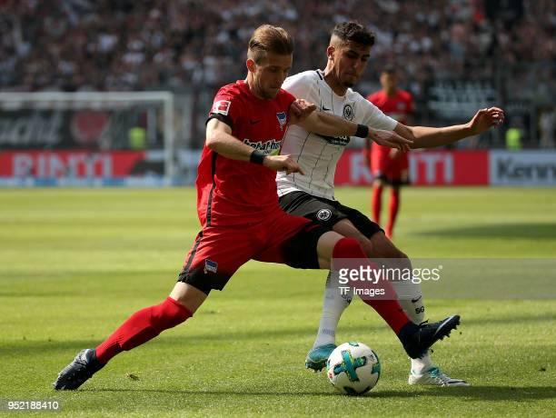 Peter Pekarik of Hertha and Aymen Barkok of Frankfurt battle for the ball during the Bundesliga match between Eintracht Frankfurt and Hertha BSC at...