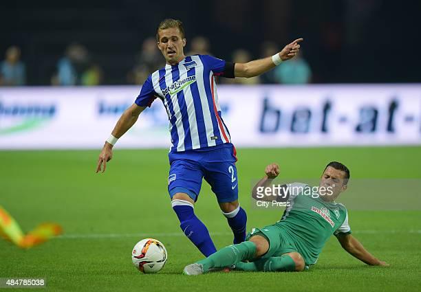 Peter Pekarik of Hertha BSC and Zlatko Junuzovic of Werder Bremen during the game between Hertha BSC and Werder Bremen on August 21 2015 in Berlin...