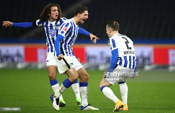 Peter Pekarik of Hertha celebrates his team's first goal with teammates Niklas Stark and Matteo Guendouzi during the Bundesliga match between Hertha...