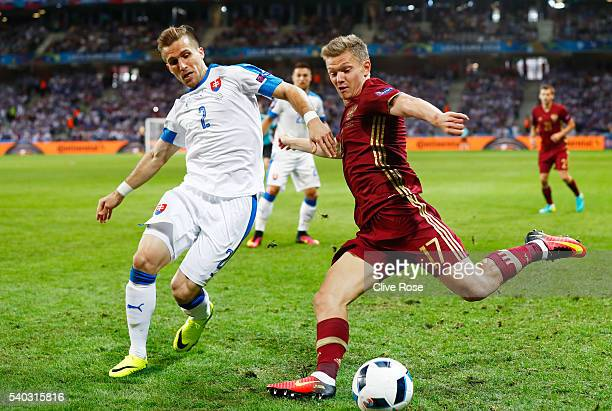 Peter Pekarik of Slovakia chases down Oleg Shatov of Russia during the UEFA EURO 2016 Group B match between Russia and Slovakia at Stade PierreMauroy...