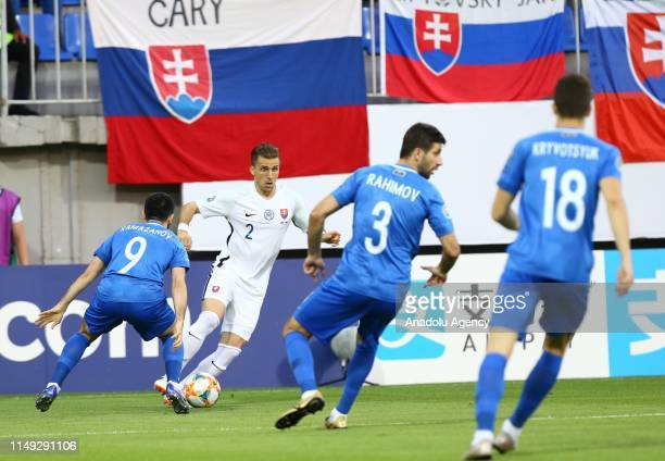 Peter Pekarik of Slovakia in action against Agabala Ramazanov of Azerbaijan during a UEFA Euro 2020 European Championship Qualifiers Group E match...