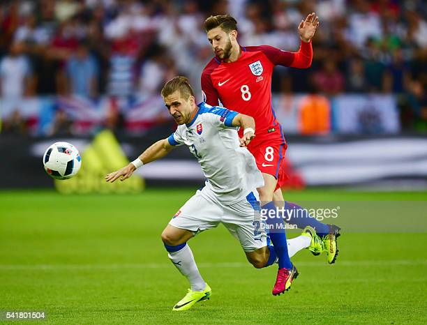 Peter Pekarik of Slovakia is challenged by Adam Lallana of England during the UEFA EURO 2016 Group B match between Slovakia and England at Stade...