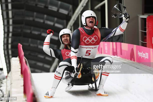 Peter Penz and Georg Fischler of Austria are celebrate as they finish run 2 during the Luge Doubles on day five of the PyeongChang 2018 Winter...