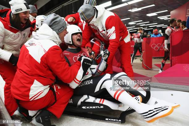 Peter Penz and Georg Fischler of Austria are congratulated as they finish run 2 during the Luge Doubles on day five of the PyeongChang 2018 Winter...