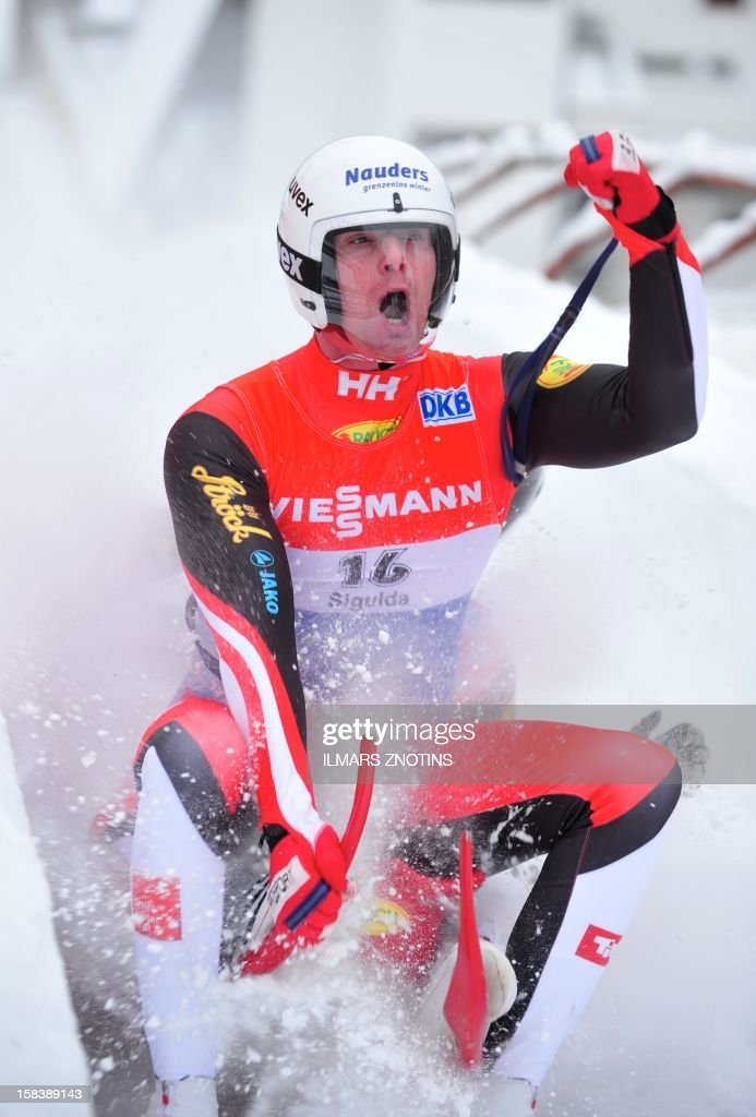 Peter Penz (front) and Georg Fischler of Austria celebrate after their run at the Luge World Cup Doubles competition on December 15 , 2012 in Sigulda, Latvia, some 50 km northeast of Riga. The pair finished second.