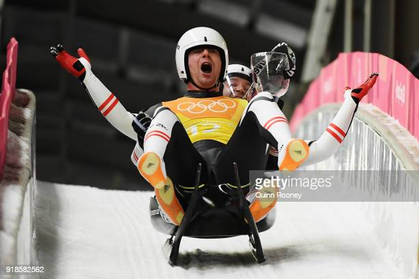 Peter Penz and Georg Fischler of Austria celebrate as they finsih a run during the Luge Team Relay on day six of the PyeongChang 2018 Winter Olympic...