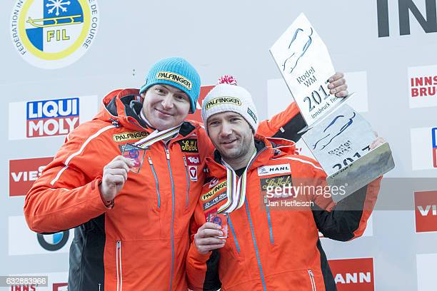 Peter Penz and Georg Fischler of Austria pose for pictures after winning the third place of the Sprint Men Double Final during the FILSprint World...