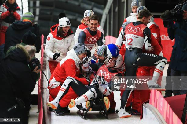 Peter Penz and Georg Fischler of Austria react following their Luge Doubles run 2 on day five of the PyeongChang 2018 Winter Olympics at the Olympic...