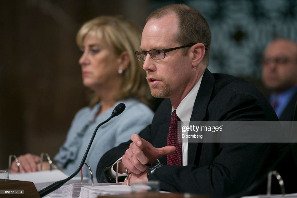 Peter 'Pete' Weiland, former head of market risk for the chief investment office at JPMorgan Chase & Co., right, speaks during a Senate Permanent Subcommittee on Investigations hearing with Ina Drew, former chief investment officer with JPMorgan Chase, in Washington, D.C., U.S., on Friday, March 15, 2013. JPMorgan Chase, the biggest U.S. bank by assets, compensated chief investment office traders in a way that encouraged risk-taking before the unit amassed losses exceeding $6.2 billion, a Senate committee said. Photographer: Andrew Harrer/Bloomberg via Getty Images