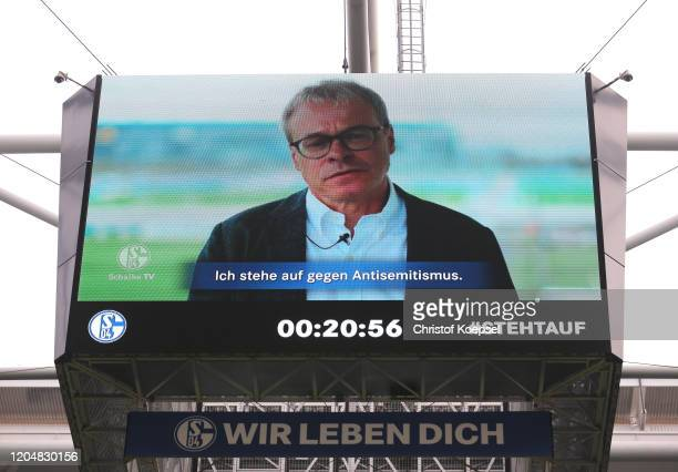 Peter Peters, board member of FC Schalke 04 is seen speaking on the big screen as part of the anti-racism campaign, #Stehtauf prior to the Bundesliga...