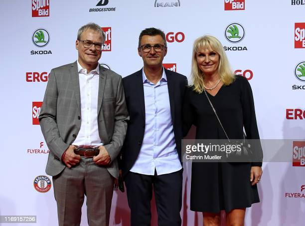 Peter Peters, Michael Köllner and his wife Petra Freitag attend the Sport Bild Award 2019 at the Fischauktionshalle on August 19, 2019 in Hamburg,...