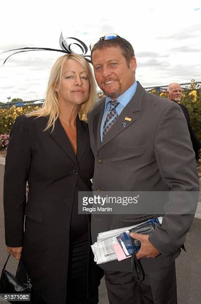 Peter Phelps and pregnant Donna Fowkes at the Melbourne Cup 2002