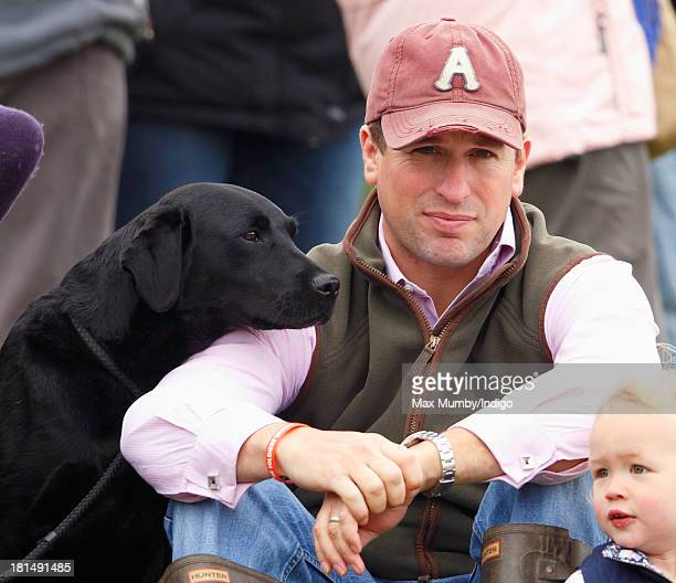 Peter Phillips accompanied by his dog watches the cross country phase of the Gatcombe Horse Trials at Gatcombe Park Minchinhampton on September 21...