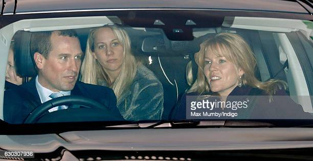 Peter Phillips and Autumn Phillips attend a Christmas lunch for members of the Royal Family hosted by Queen Elizabeth II at Buckingham Palace on...