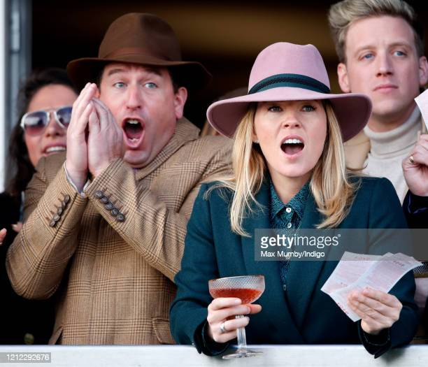 Peter Phillips and Autumn Phillips react as they watch the racing on day 4 'Gold Cup Day' of the Cheltenham Festival 2020 at Cheltenham Racecourse on...
