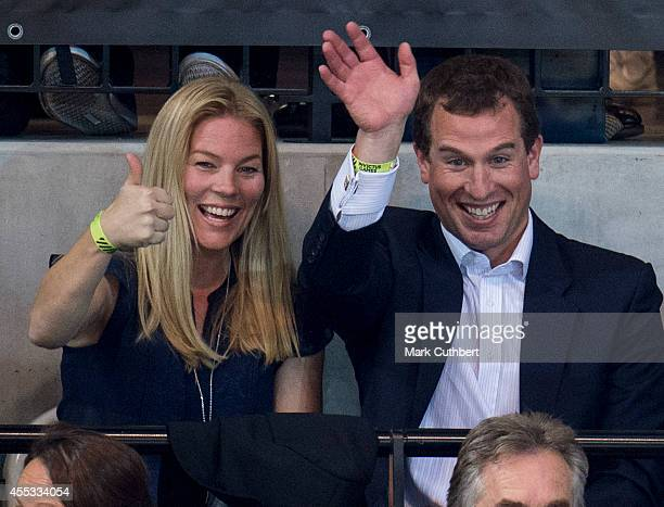 Peter Phillips and Autumn Phillips watch an exhibition Wheelchair Rugby match during The Invictus Games on September 12 2014 in London England