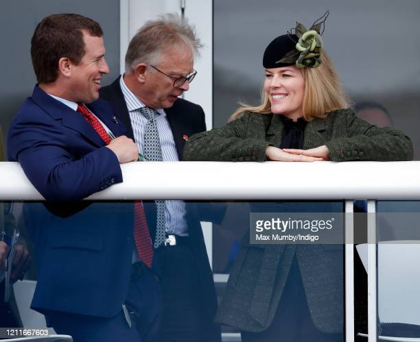 Peter Phillips and Autumn Phillips watch the racing as they attend day 1 'Champion Day' of the Cheltenham Festival 2020 at Cheltenham Racecourse on...
